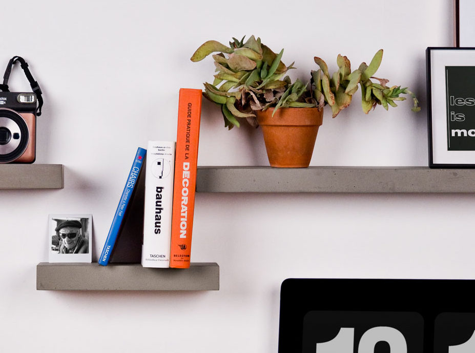 Even seen from below, the hardware of our shelves made of concrete is not visible and makes your office elegantly decorated