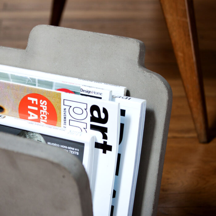 Closer view of our magazine rack. Concrete is a material evolving with time the best way